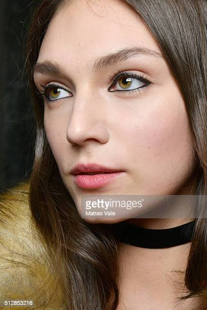 A model is seen backstage ahead of the Au Jour Le Jour show during Milan Fashion Week Fall/Winter 2016/17 on February 28 2016 in Milan Italy