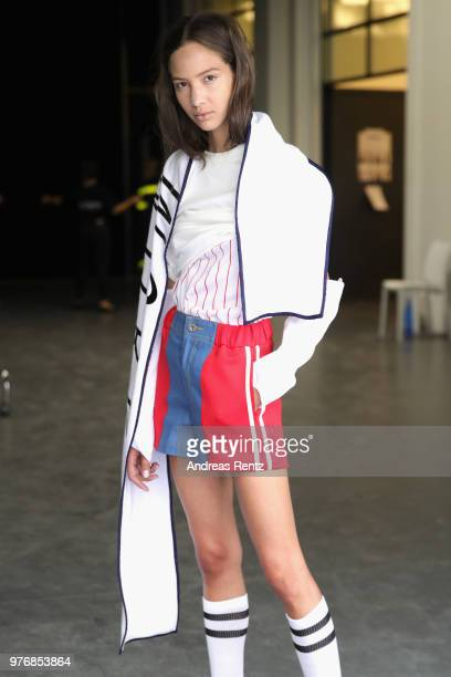 Fashion designer Bona Kim prepares a model seen backstage ahead of the Besfxxk show during Milan Men's Fashion Week Spring/Summer 2019 on June 17...