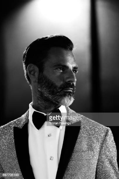 A model is seen backstage ahead of the Billionaire show during Milan Men's Fashion Week Spring/Summer 2018on June 19 2017 in Milan Italy