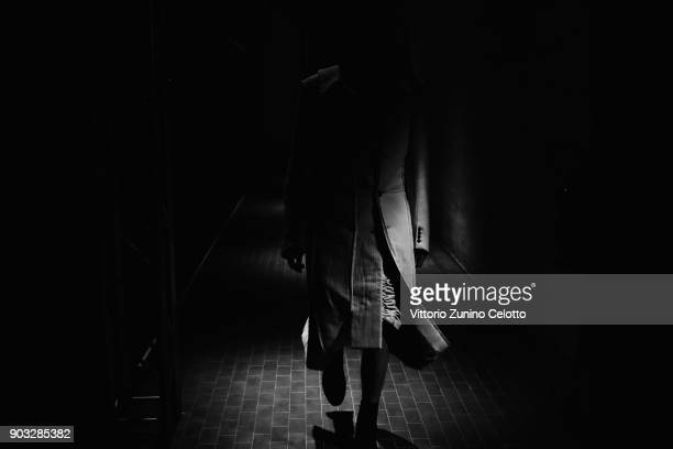 A model is seen backstage ahead of the Concept Korea Beyond Closet e Bmuet show during the 93 Pitti Immagine Uomo at Fortezza Da Basso on January 10...