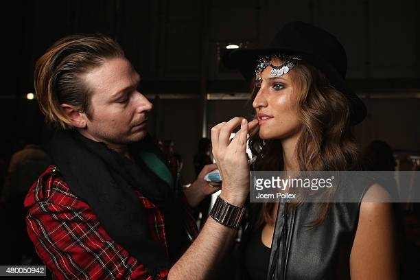 Model is seen backstage ahead of the Dimitri show during the Mercedes-Benz Fashion Week Berlin Spring/Summer 2016 at Brandenburg Gate on July 9, 2015...