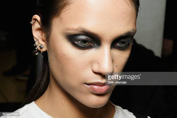 A model is seen backstage ahead of the Dirk Bikkembergs show during Milan Men's Fashion Week Fall/Winter 2016/17 on January 19 2016 in Milan Italy