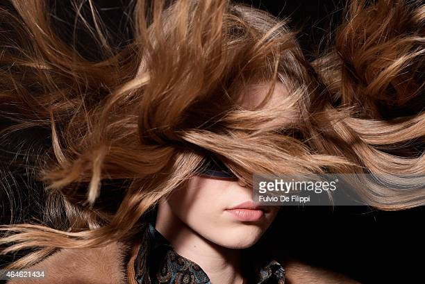 Model is seen backstage ahead of the Etro show during the Milan Fashion Week Autumn/Winter 2015 on February 27, 2015 in Milan, Italy.