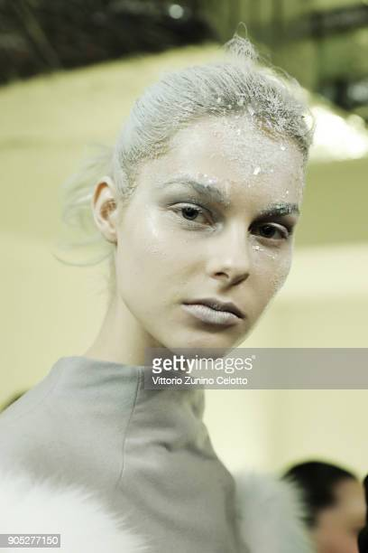 A model is seen backstage ahead of the Frankie Morello show during Milan Men's Fashion Week Fall/Winter 2018/19 on January 15 2018 in Milan Italy