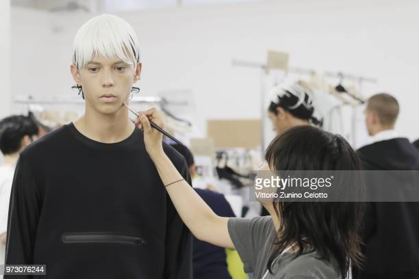 A model is seen backstage ahead of the Fumito Ganryu show during the 94th Pitti Immagine Uomo on June 13 2018 in Florence Italy