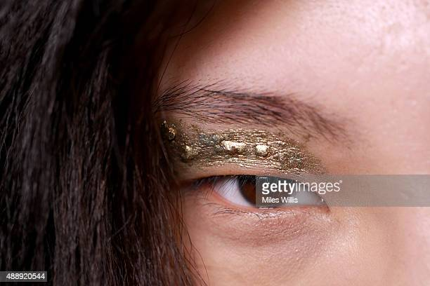 Model is seen backstage ahead of the Fyodor Golan show during London Fashion Week Spring/Summer 2016 on September 18, 2015 in London, England.