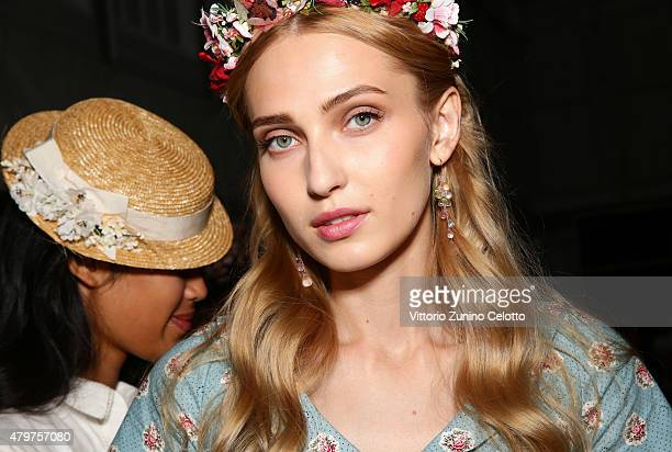 A model is seen backstage ahead of the Lena Hoschek show during the MercedesBenz Fashion Week Berlin Spring/Summer 2016 at Brandenburg Gate on July 7...