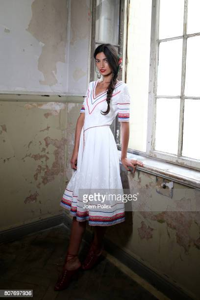 A model is seen backstage ahead of the Lena Hoschek show during the MercedesBenz Fashion Week Berlin Spring/Summer 2018 at Kaufhaus Jandorf on July 4...