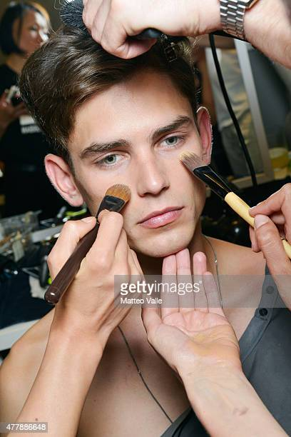 A model is seen backstage ahead of the Les Hommes show during the Milan Men's Fashion Week Spring/Summer 2016 on June 20 2015 in Milan Italy