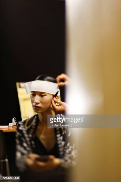 A model is seen backstage ahead of the Lucio Vanotti show during Milan Fashion Week Spring/Summer 2018on September 21 2017 in Milan Italy