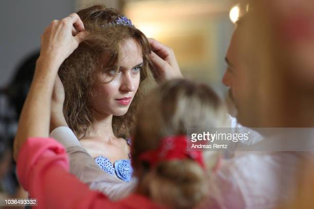 A model is seen backstage ahead of the Luisa Beccaria show during Milan Fashion Week Spring/Summer 2019 on September 20 2018 in Milan Italy