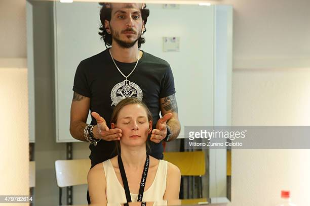A model is seen backstage ahead of the Marcel Ostertag show during the MercedesBenz Fashion Week Berlin Spring/Summer 2016 at Admiralspalast on July...