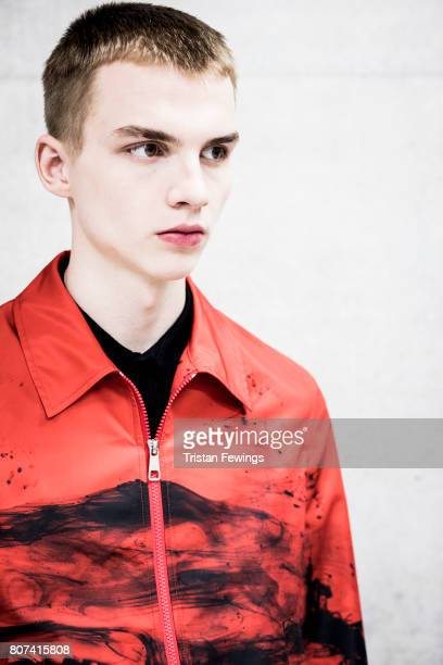 Image processed using digital filters A model is seen backstage ahead of the Neil Barrett show during Milan Men's Fashion Week Spring/Summer 2018on...