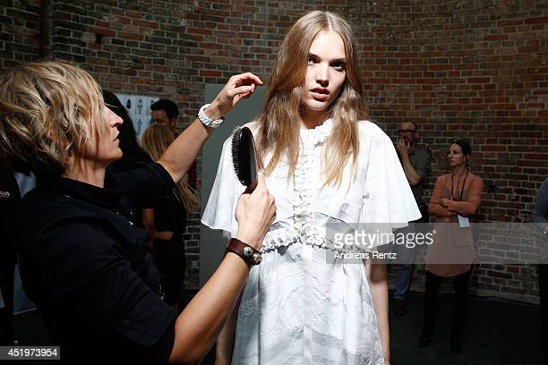 A model is seen backstage ahead of the Schumacher show during the MercedesBenz Fashion Week Spring/Summer 2015 at Sankt Elisabeth Kirche on July 10...