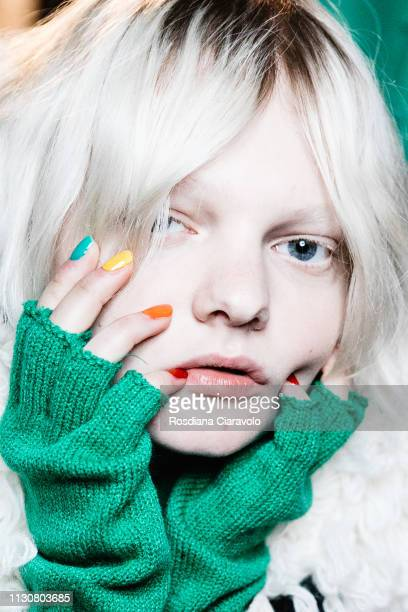 A model is seen backstage ahead of the United Colours Of Benetton show at Milan Fashion Week Autumn/Winter 2019/20 on February 19 2019 in Milan Italy