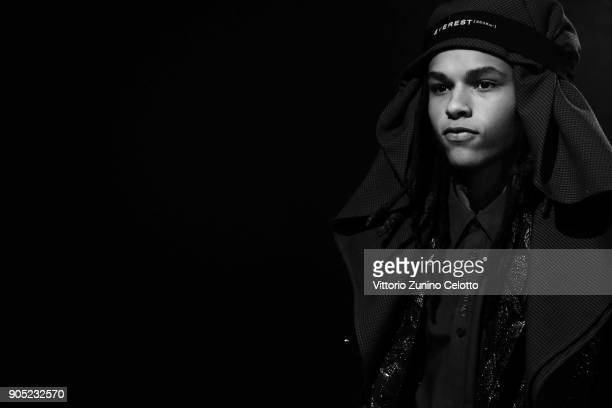 A model is seen backstage ahead of the Yoshio Kubo show during Milan Men's Fashion Week Fall/Winter 2018/19 on January 15 2018 in Milan Italy