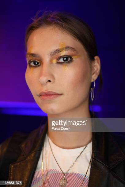A model is seen backstage ahead the Guntas show during MercedesBenz Istanbul Fashion Week at the Zorlu Performance Hall on March 19 2019 in Istanbul...