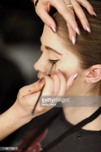 A model is seen backstage at the Emre Pakel show during MercedesBenz Istanbul Fashion Week at the Zorlu Performance Hall on March 19 2019 in Istanbul...
