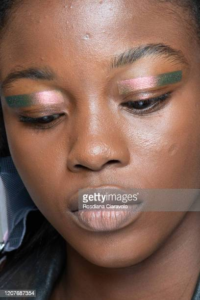 Model is seen backstage at the Prada fashion show on February 20, 2020 in Milan, Italy.