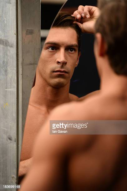 A model is seen backstage at the Serdar Uzuntas show during MercedesBenz Fashion Week Istanbul s/s 2014 presented by American Express on October 9...