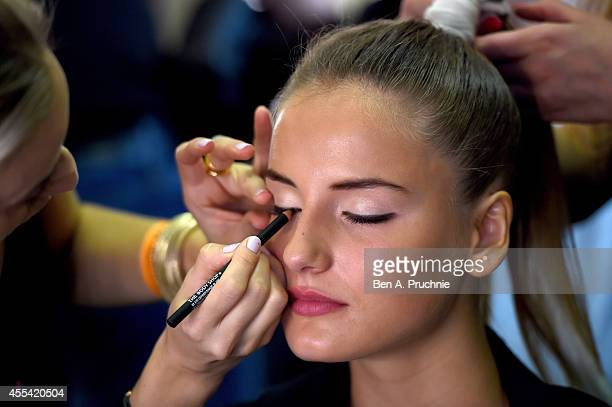 A model is seen backstage prior the Apu Jan show during London Fashion Week Spring Summer 2015 at Fashion Scout Venue on September 14 2014 in London...