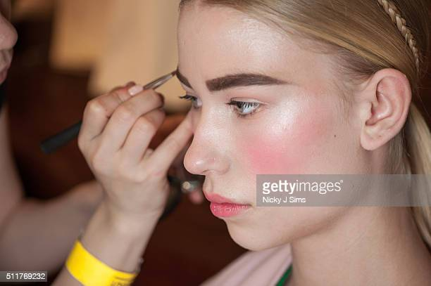 A model is seen backstage prior to the FAD show on day 4 of London Fashion Week Autumn Winter 2016 at Fashion Scout Venue on February 22 2016 in...