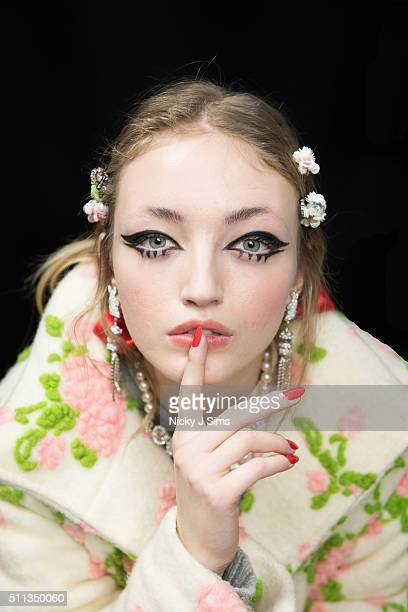 A model is seen backstage prior to the Ryan Lo show on day 1 of London Fashion Week Autumn Winter 2016 at BFC Showspace on February 19 2016 in London...