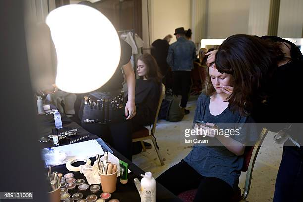 A model is seen being styled backstage ahead of the James Kelly show at Fashion Scout during London Fashion Week Spring/Summer 2016 on September 19...