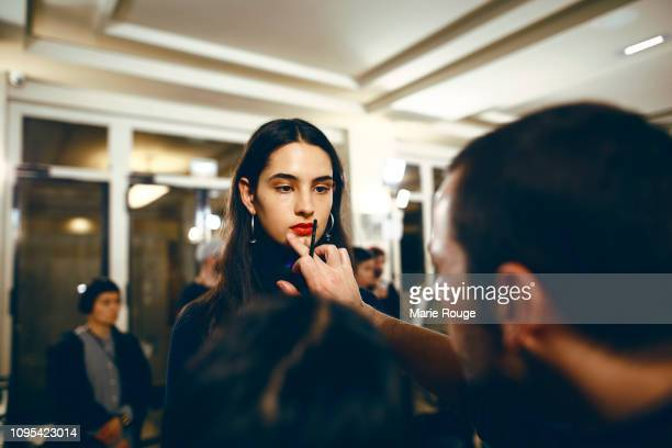 A model is seen getting her makeup done backstage before the Ami Alexandre Mattiussi Menswear Fall/Winter 20192020 show at Palais de Chaillot on...