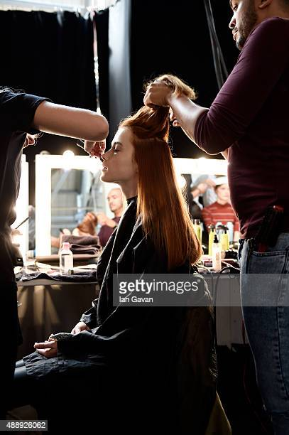 Model is seen getting ready backstage ahead of the Bora Aksu show during London Fashion Week Spring/Summer 2016 on September 18, 2015 in London,...