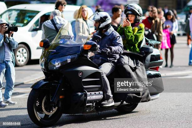 A model is seen on a motorbike taxi outside the Dries Van Noten show during Paris Fashion Week Womenswear Spring/Summer 2018 on September 27 2017 in...