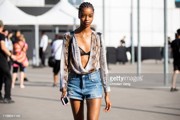 A model is seen outside Acne during Paris Fashion Week Haute Couture Fall/Winter 2019/2020 on June 30 2019 in Paris France