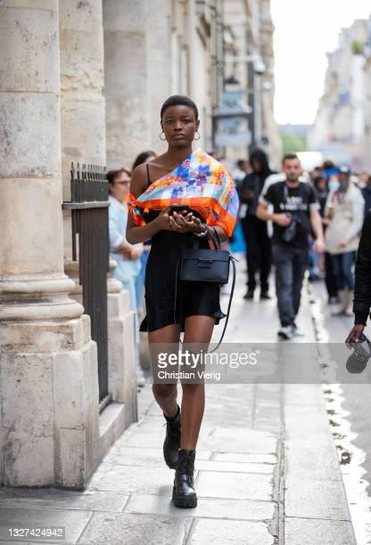 Model is seen outside Armani on July 06, 2021 in Paris, France.