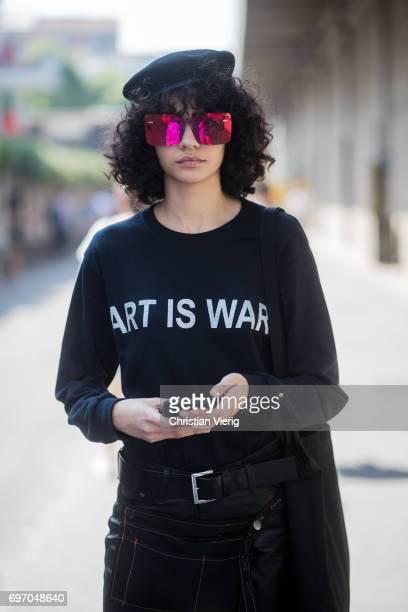 Model is seen outside Diesel during Milan Men's Fashion Week Spring/Summer 2018 on June 17, 2017 in Milan, Italy.