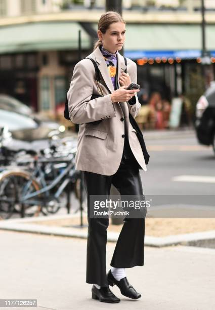 Model is seen outside the Dries Van Noten show during Paris Fashion Week SS20 on September 25, 2019 in Paris, France.