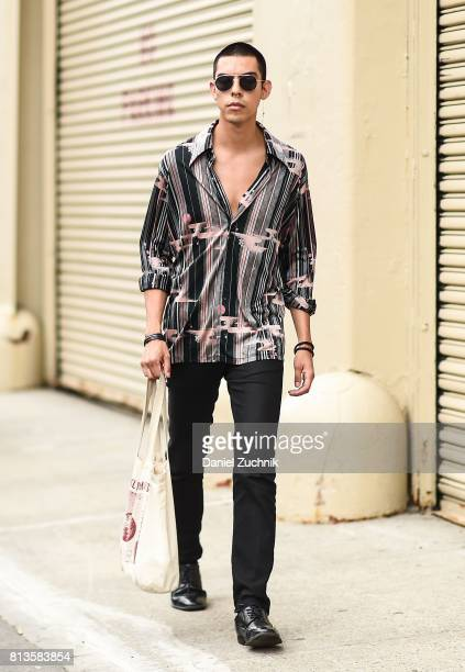 A model is seen outside the Kenneth Ning show during New York Fashion Week Men's S/S 2018 at Skylight Clarkson Sq on July 12 2017 in New York City
