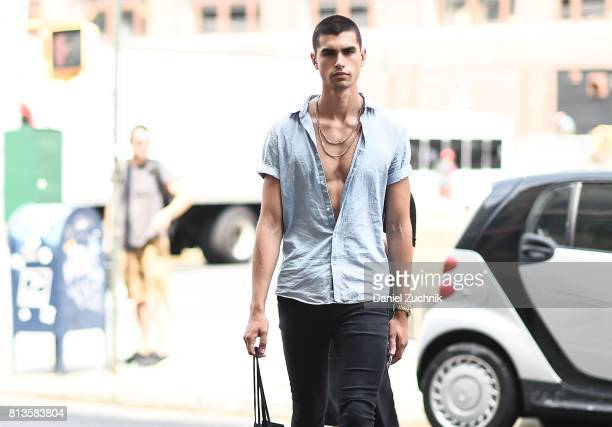 A model is seen outside the Parke Ronen show during New York Fashion Week Men's S/S 2018 at Skylight Clarkson Sq on July 12 2017 in New York City