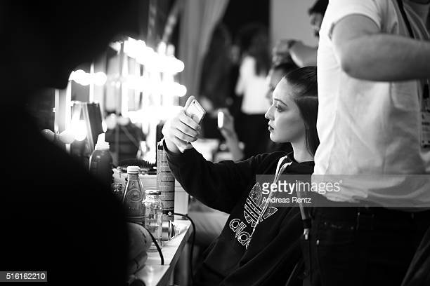 A model is seen taking a selfie backstage ahead of the Afffair show during the MercedesBenz Fashion Week Istanbul Autumn/Winter 2016 at Zorlu Center...