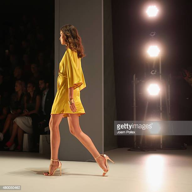 Model is seen walking the runway from backstage at the Dimitri show during the Mercedes-Benz Fashion Week Berlin Spring/Summer 2016 at Brandenburg...