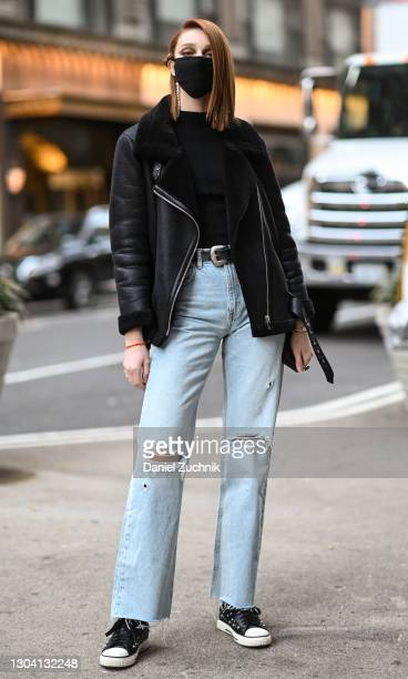 Model is seen wearing a black jacket, black top, blue jeans and Converse sneakers outside the Christian Siriano show during New York Fashion Week...