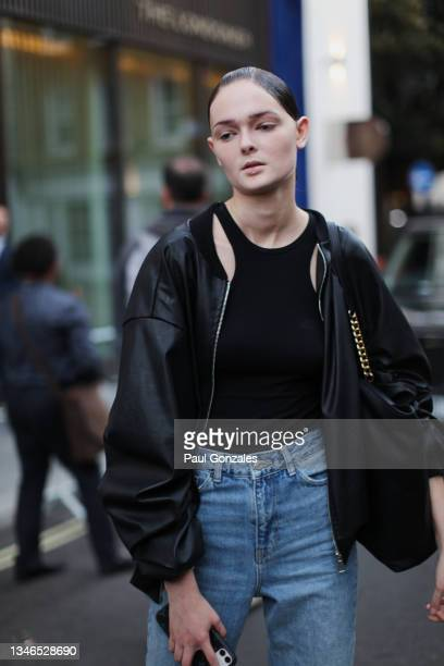 Model is seen wearing a Black Leather Blouson at Richard Quinn, during London Fashion Week September 2021 on September 21, 2021 in London, England.