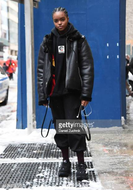 A model is seen wearing a black leather coat and black pants and Fila sneakers outside the Coach 1941 show during New York Fashion Week Fall/Winter...