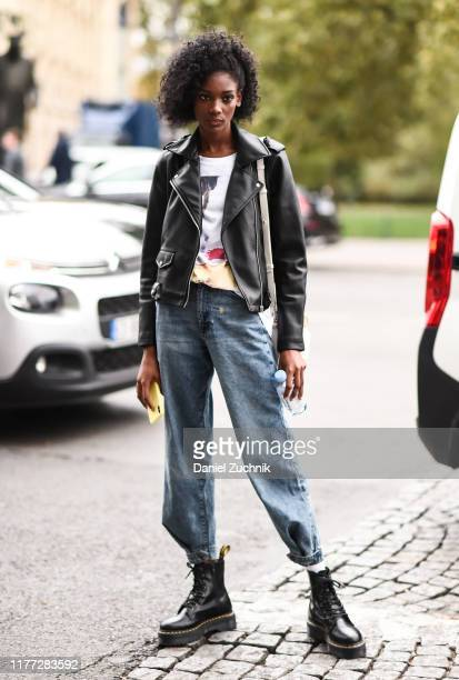 Model is seen wearing a black leather jacket, blue jeans and black boots outside the Chloe show during Paris Fashion Week SS20 on September 26, 2019...