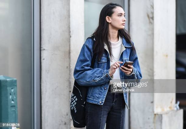 A model is seen wearing a blue jean jacket and dark blue jeans outside the Esteban Cortazar show during New York Fashion Week Women's A/W 2018 on...
