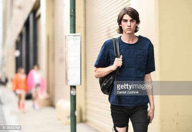 A model is seen wearing a blue shirt and black jeans outside the Parke Ronen show during New York Fashion Week Men's S/S 2018 at Skylight Clarkson Sq...