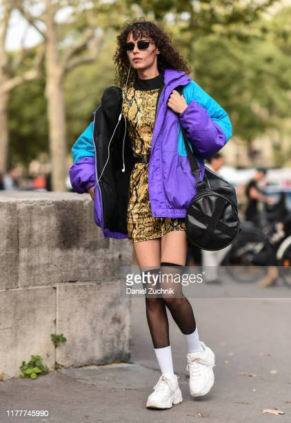 Model is seen wearing a gold snakeskin dress outside the Haider Ackermann show during Paris Fashion Week SS20 on September 28, 2019 in Paris, France.