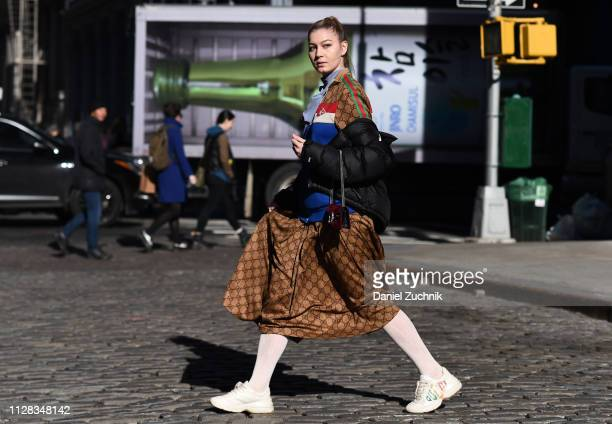 A model is seen wearing a Gucci dress Gucci sneakers and Gucci bag outside the Jason Wu show during New York Fashion Week Fall/Winter 2019 on...