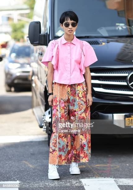 A model is seen wearing a pink top and floral pants outside the 31 Phillip Lim show during New York Fashion Week Women's S/S 2018 on September 11...