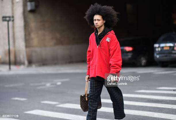 A model is seen wearing a red Marlboro jacket and black striped pants outside of the General Idea show during New York Fashion Week Men's AW17 on...