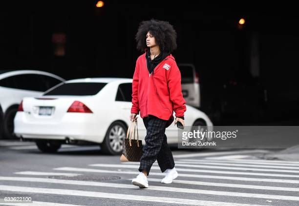 A model is seen wearing a red Marlboro jacket black striped pants and white sneakers outside of the General Idea show during New York Fashion Week...